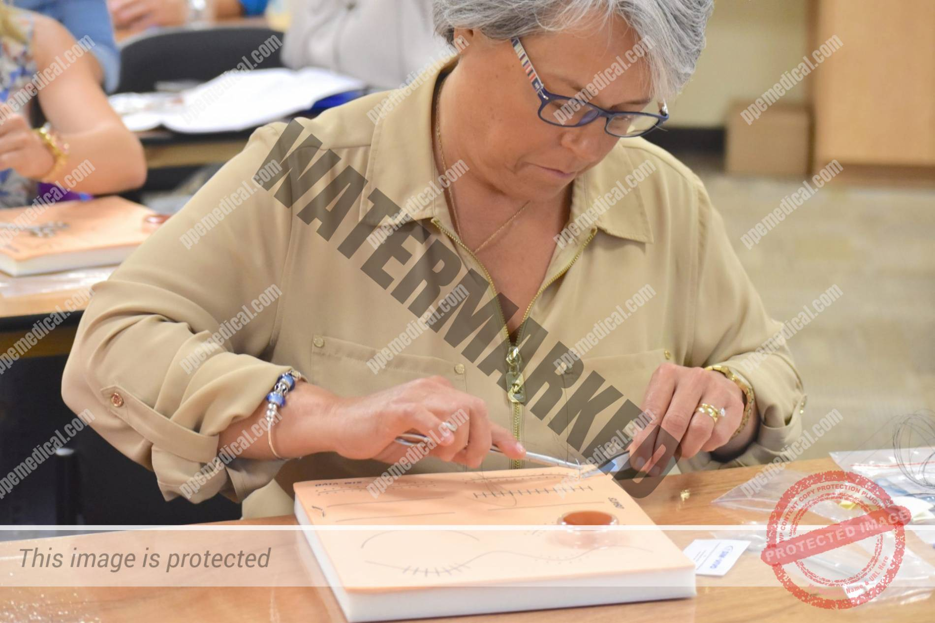 PPE Medical Student Works on Suturing Exercise