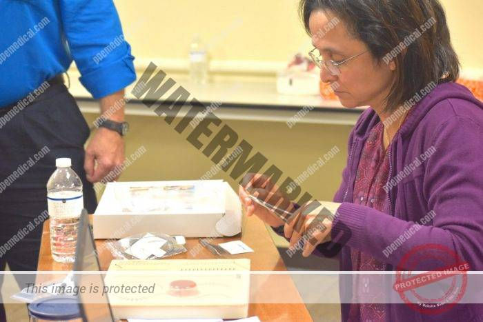 Medical professionals practice suturing